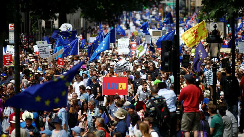 European Union supporters, calling on the government to give Britons a vote on the final Brexit deal, participate in the People's Vote march in central London, Britain, on June 23.