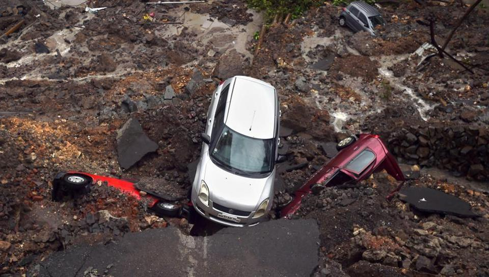 The landslide buried six cars in the parking lot on Monday.