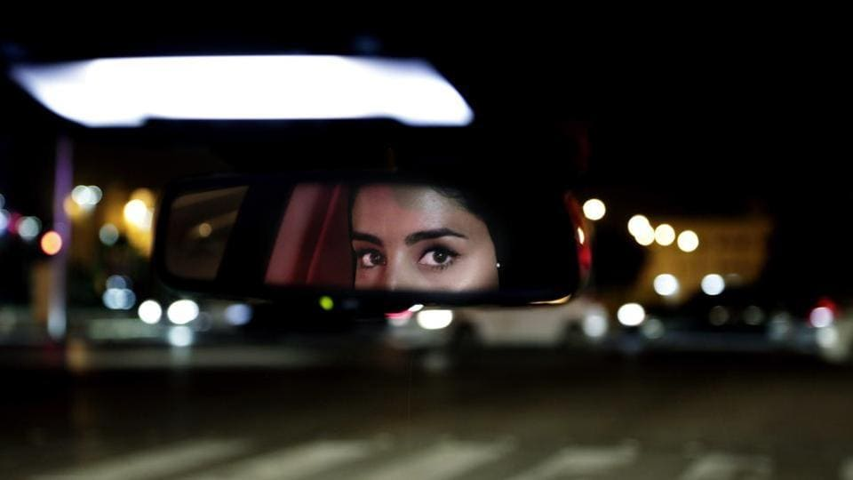 Hessah al-Ajaji drives her car down the busy Tahlia Street after midnight for the first time in Riyadh, Saudi Arabia, Sunday, June 24, 2018. Saudi women are in the driver's seat for the first time in their country and steering their way through busy city streets just minutes after the world's last remaining ban on women driving was lifted on Sunday.