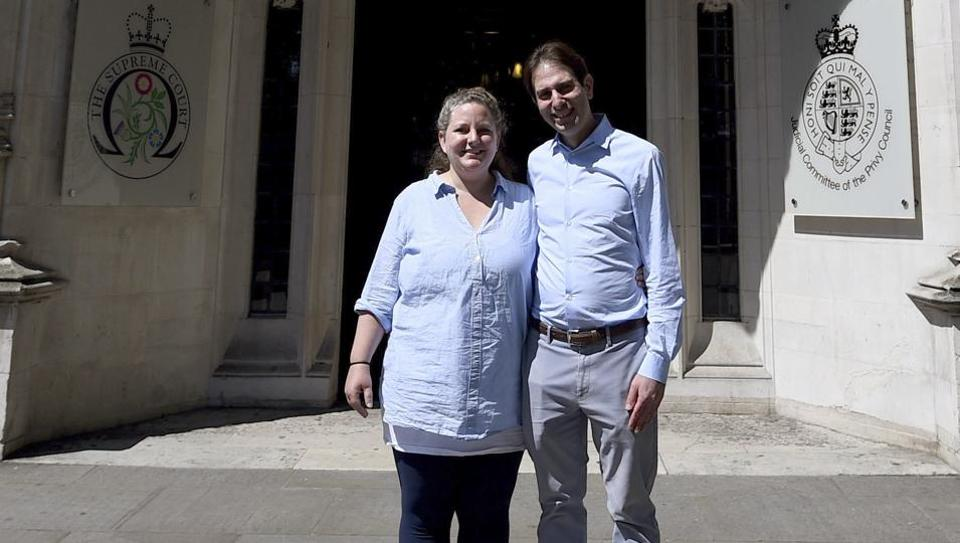 Rebecca Steinfeld and Charles Keidan pose together outside the Supreme Court in London, where they have won their fight for the right to enter into a civil partnership, Thursday June 27.