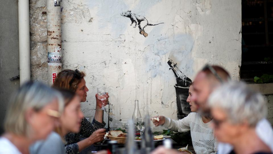 This second of three rat themed pieces shows a rodent case flying through the air, riding the cork from a champagne bottle. Meanwhile diners sip on their drinks in the foreground –a fitting placement. (Benoit Tessier / REUTERS)