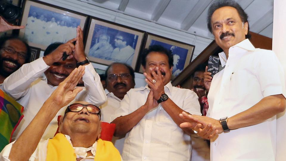 DMK chief M Karunanidhi (in yellow) with party working president MKStalin on his 95th birthday in Chennai on June 3, 2018.