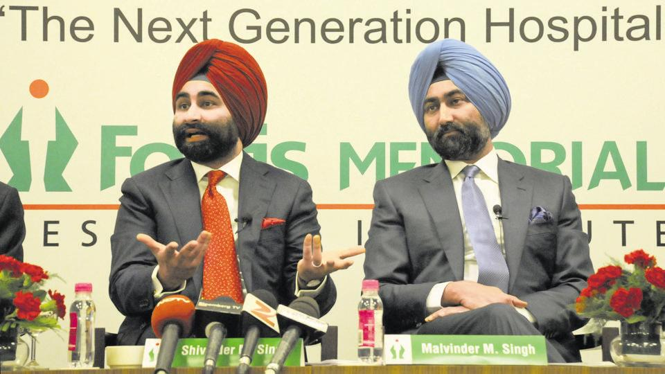 Fortis Healthcare's Executive Vice Chairman Shivinder Mohan Singh (L) and Executive Chairman Malvinder Mohan during an event in Gurgaon.