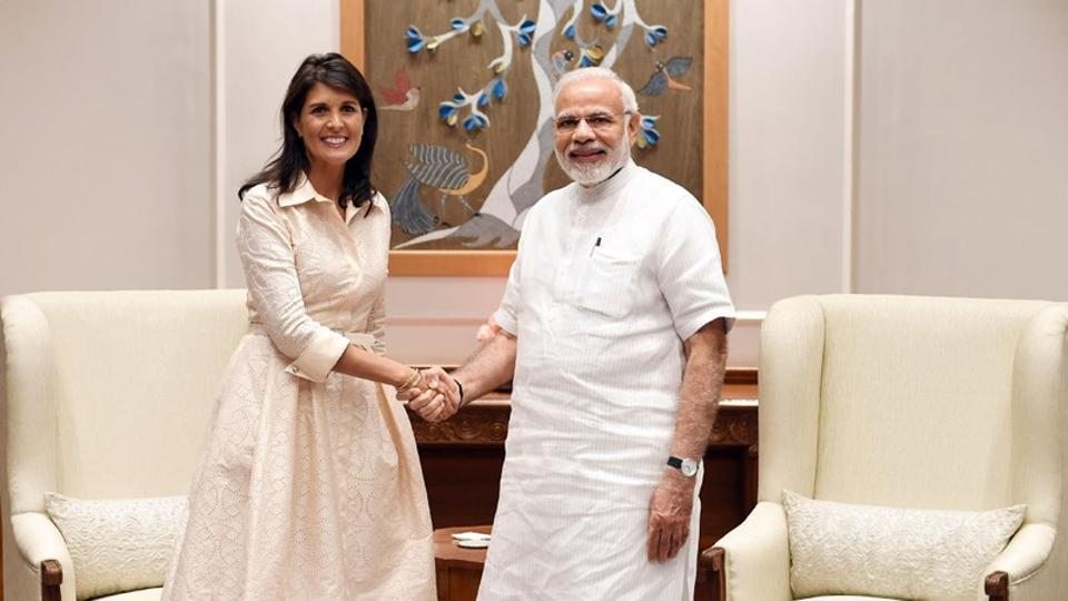 Prime Minister Narendra Modi shakes hands with US Ambassador to the United Nations Nikki Haley before the start of their meeting in New Delhi.