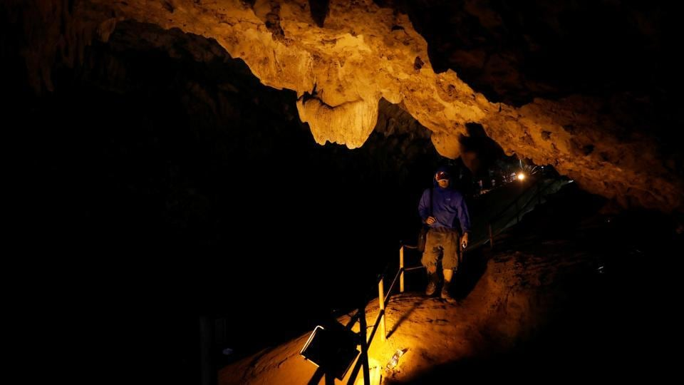A rescue worker walks in Tham Luang cave. Nothing has been heard of the missing people and no sign found yet, apart from some footprints and marks left by their muddy hands near the cave entrance. (Soe Zeya Tun / REUTERS)