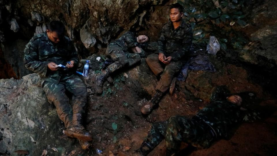 Soldiers rest during the rescue operation. Chiang Rai Governor Narongsak Osottanakorn said rescuers have identified three chimneys, or shafts, rising up from the roof of the cave to the open air on the mountain above and hoped to descend through one of them. (Soe Zeya Tun / REUTERS)