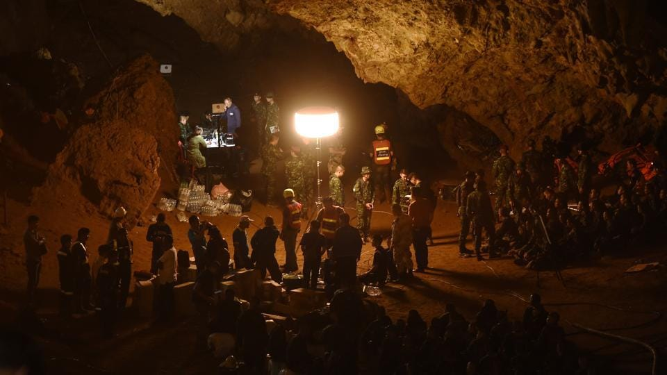 Thai soldiers relay electric cable deep into the cave at Chiang Rai's Khun Nam Nang Non Forest Park during the rescue operation. Volunteers and military teams, including a navy SEAL unit, struggled through flood waters inside the cave on Wednesday in a search for the missing. (Lillian Suwanrumpha / AFP)