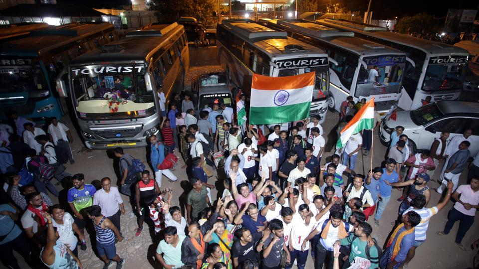 Devotees chant religious slogans as the first batch of pilgrims leave for Amarnath Yatra. Security has been tightened for the visit to the shrine. The Hizbul Mujahideen militant group in Kashmir has apparently said it has no plans to attack the pilgrimage. An audio message believed to be from Hizbul Mujahideen operational commander Riyaz Ahmad Naikoo sought to assure pilgrims that they could go on the yatra even without security cover. (Nitin Kanotra / HT Photo)