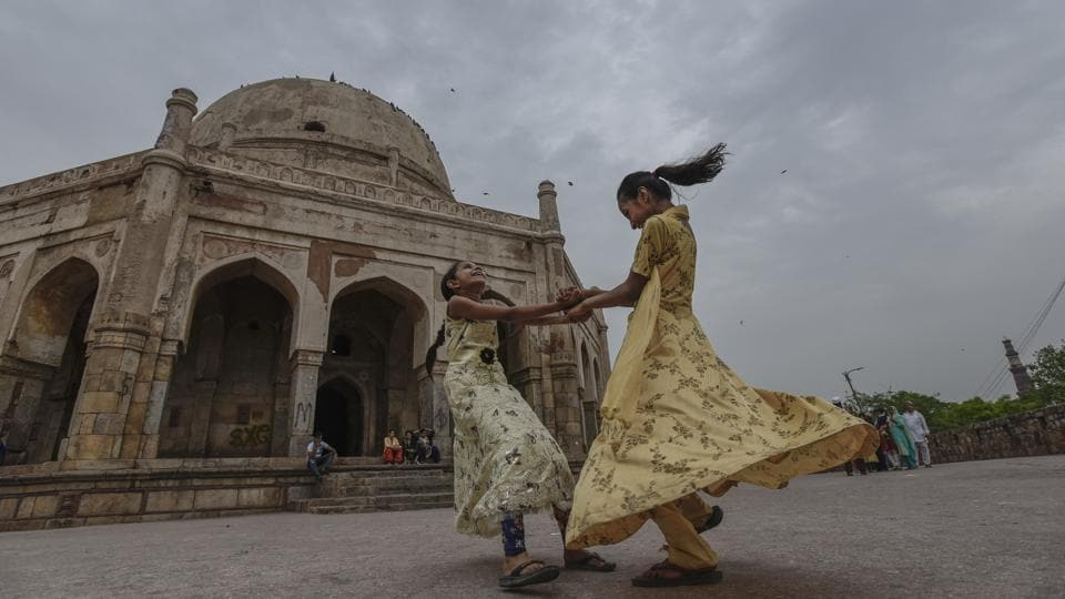 Children play in the compound of Adham Khan's Tomb in Mehrauli, as dark clouds hover over New Delhi. The normal date for monsoon's onset in Delhi is June 29. Pre-monsoon thunderstorms and rain have also commenced in most parts of Himachal Pradesh and conditions are favourable for the arrival of southwest monsoon in the state in the next few days. (Burhaan Kinu / HT Photo)
