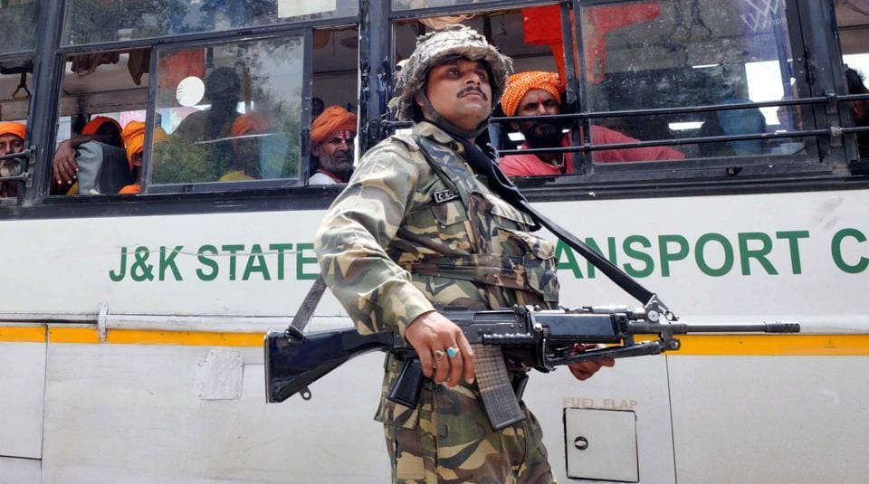A CRPF soldier guards the bus carrying Amarnath Yatra pilgrims  on August 05, 2015.