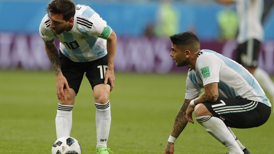 Argentina's Lionel Messi, left, is flanked by his teammate Ever Banega during the FIFA World Cup 2018 Group D match against Nigeria.