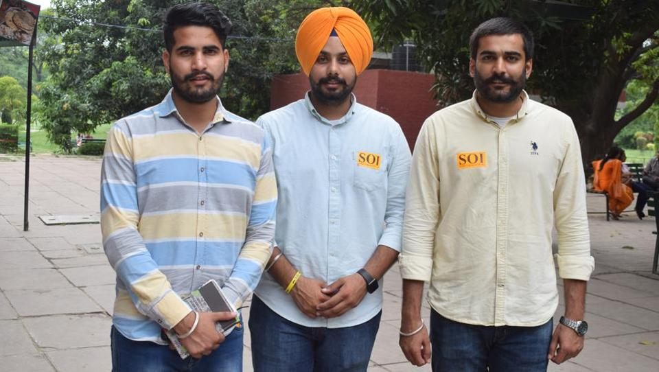 SOI's PU student union presidential candidate Iqbalpreet Prince flanked by the party leaders Chetan Chaudhary (left) and Mehnazpreet Chahal on the campus on Wednesday.