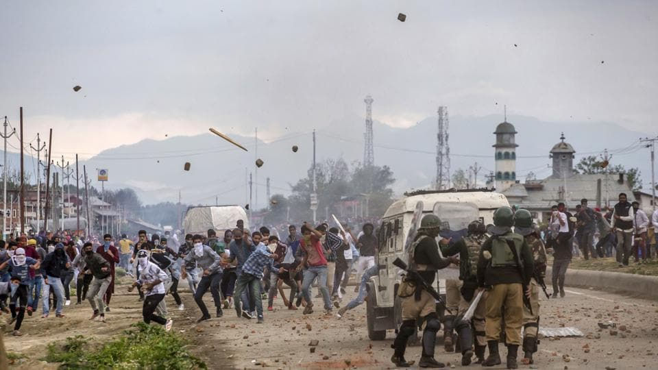 Protesters throw stones and bricks at paramilitary soldiers during a protest on the outskirts of Srinagar, Kashmir.