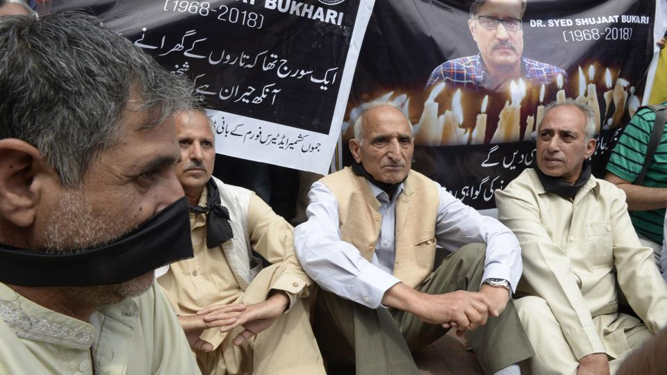 Mediapersons stage a protest against the killing of veteran journalist Shujaat Bukhari and a provocative remark by Bharatiya Janata Party leader Lal Singh in Srinagar on Tuesday.
