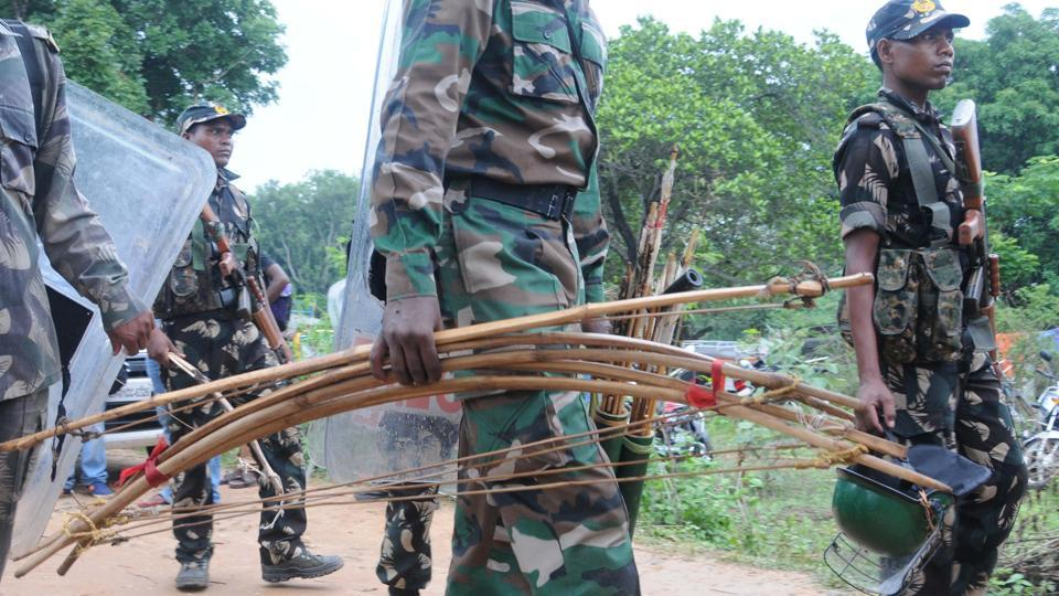 Police seized traditional weapons after a raid of the Ghaghra village to arrest those accused in the gangrape of five women activists, in Khunti on June 27, 2018.