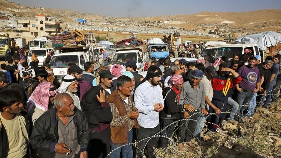 Lebanon's government has argued that many areas in Syria have become stable enough for refugees to return. The Syrian army, backed by allies Russia and Iran, has regained more territory from rebels,  But the UN is cautious, saying Syria is not yet safe. (Bilal Hussein / AP)