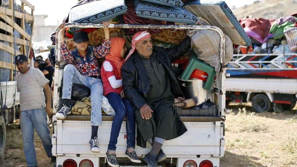 Hundreds of displaced Syrians left Lebanon for their war-torn homeland on Thursday in a repatriation that will reunite them with relatives they haven't seen for years. But many are also leaving behind loved ones who are staying in the tiny Arab nation that has become home to the highest percentage of refugees in the world. (Bilal Hussein / AP)