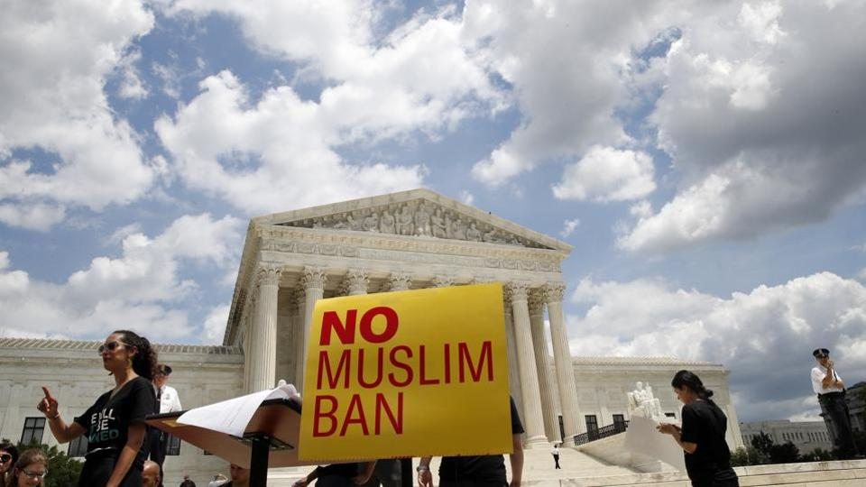 People protest against the US Supreme Court ruling upholding President Donald Trump's controversial order, which prevents nationals of several Muslim-majority nations from entering the country. (Jacquelyn Martin / AP)