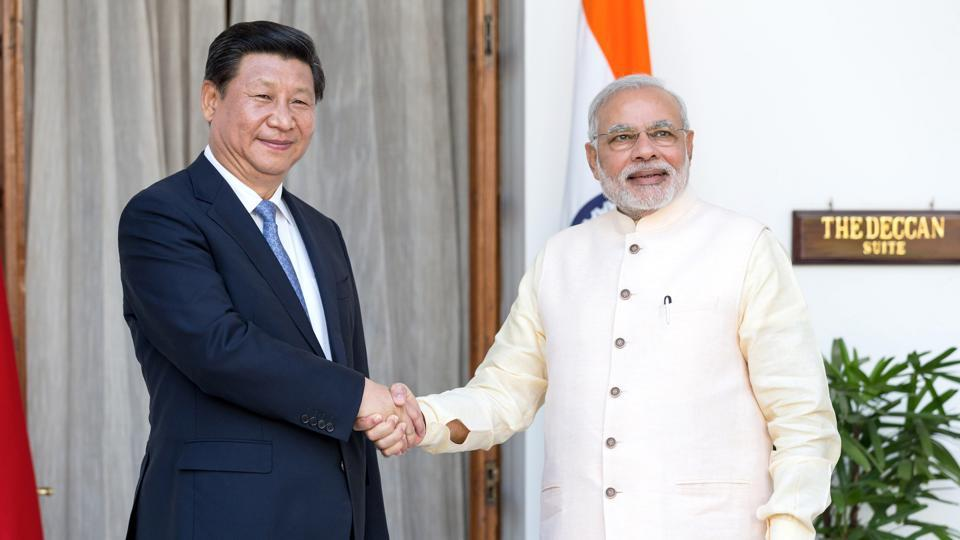 Prime Minister Narendra Modi, right, shakes hands with Xi Jinping, China's president, as they arrive for delegation talks at Hyderabad House in New Delhi, India, on Thursday, September 18, 2014.