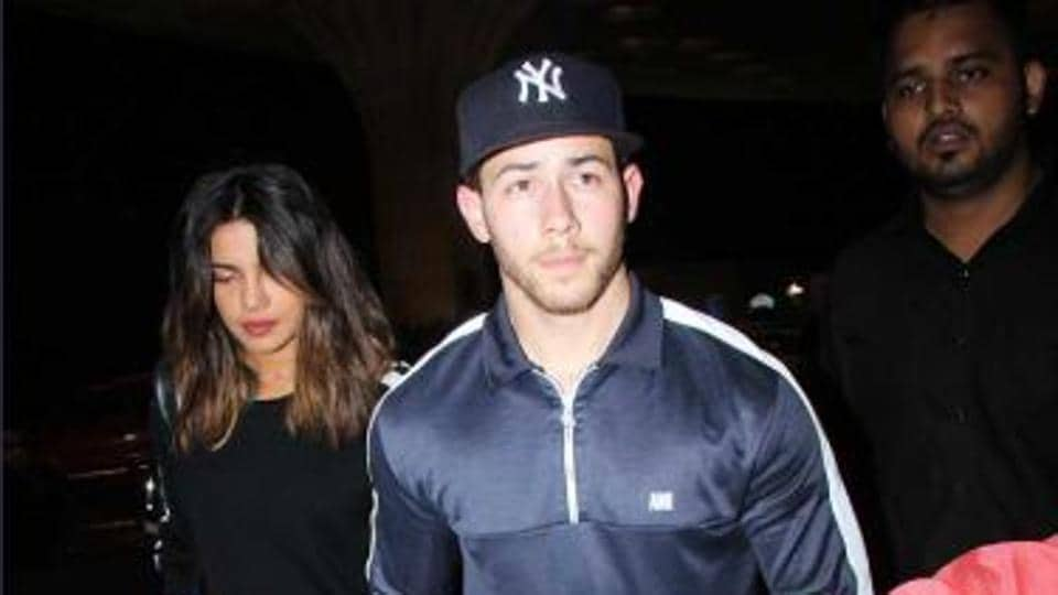 Nick Jonas leads Priyanka Chopra by hand as the couple returns to US after week-long stay.