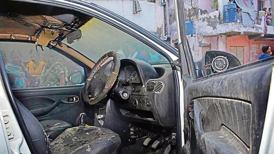 Photo of the cab in which 25­-year-­old cab driver Renu Chaudhury was found burnt, near Model Town underpass on the night of June 24.