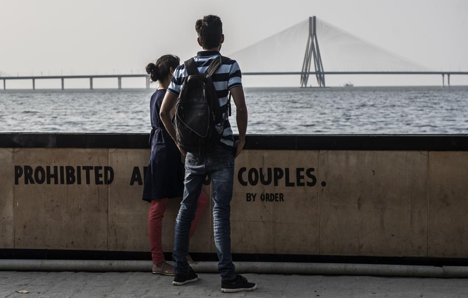 Living through the drama: Couples at Dadar Chowpatty in Mumbai.