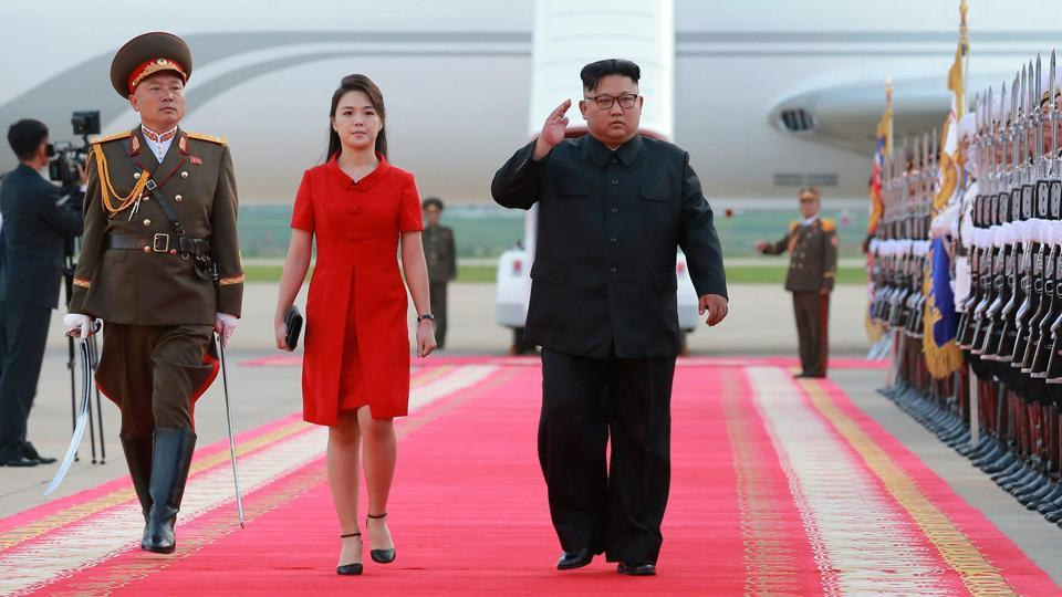 In this photo provided by the North Korean government, Kim Jong Un and his wife Ri Sol Ju arrive at Pyongyang International Airport.
