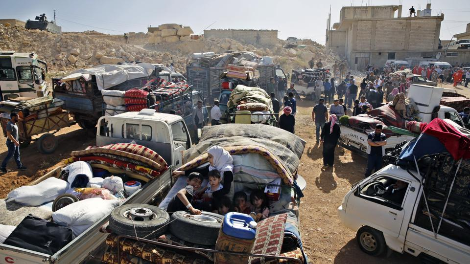 "People gathered in minivans and tractors in the morning, loading them with mattresses, water tanks and furniture. Lama Fakih, deputy director of the Middle East region for Human Rights Watch, said Syrians are often driven to leave by ""oppressive"" living conditions in Lebanon, including a lack of residency rights, restrictions on their movement and inability to enrol children in school. (Bilal Hussein / AP)"