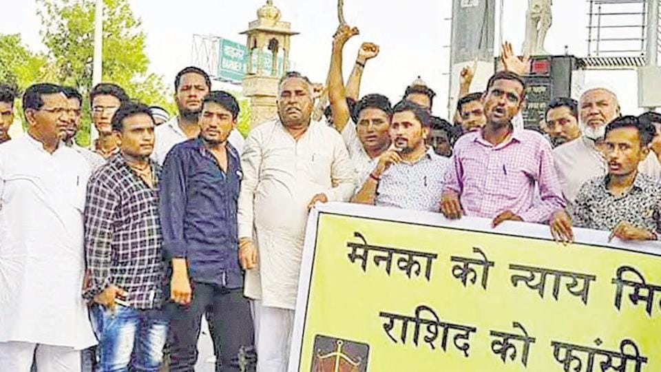 BJP district president Jalam Singh Rawalot and former president Aaduram Meghwal protest against the rape and murder of a minor Dalit girl in Barmer.