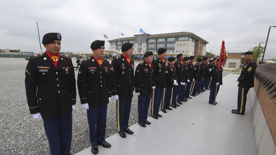US Army soldiers stand as they wait for an opening ceremony for the new headquarters of the US Forces Korea (USFK) at Camp Humphreys in Pyeongtaek, South KoreaSe