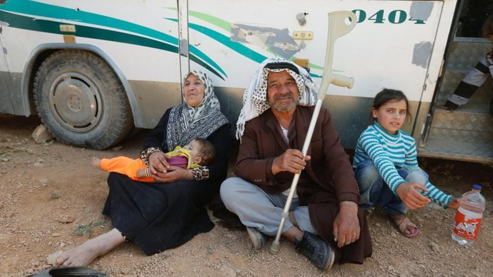 "Mohammed Suleiman Darwish, 76, was among those who left this border town for Syria with his 9-year-old granddaughter, Israa, who has not seen her parents since 2013 and will meet younger siblings who were born while she sought safety in Lebanon. ""I want to see them today,"" said the green-eyed girl who seemed excited about the trip. (Mohamed Azakir / REUTERS)"