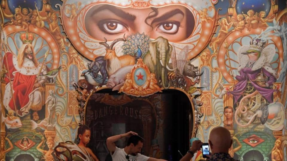 Visitors take photos beside the Detail of the King of Pop by Mark Ryden which forms part of the exhibition.