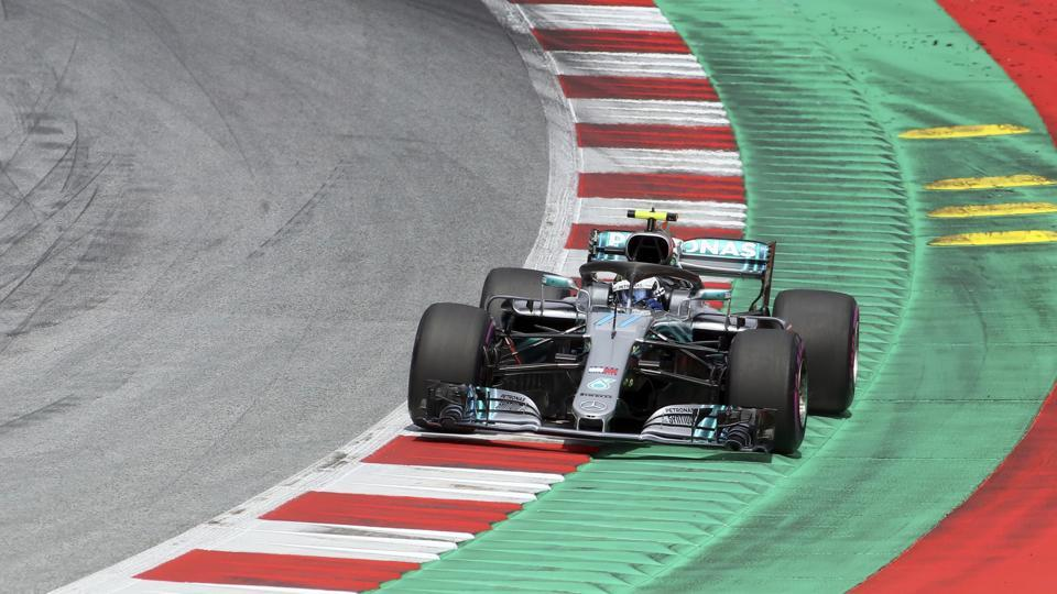 Mercedes driver Valtteri Bottas of Finland takes a curve during the qualifying session for the Austrian Formula One Grand Prix at the Red Bull Ring racetrack.