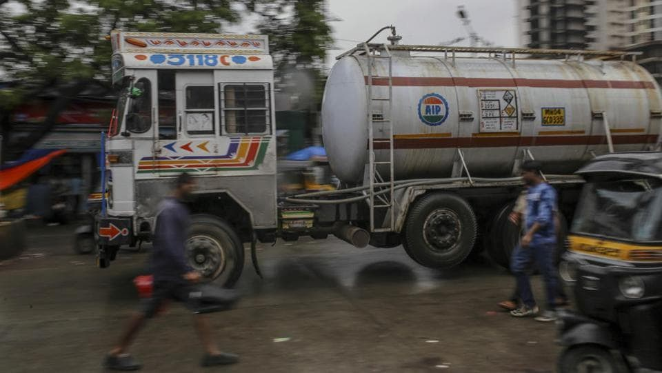 A fuel tanker drives along a street in Mumbai. Concerns about the government's debt sales and the impact of rising crude prices on inflation have led to a bond sell off at time when investors are also pulling out of emerging markets because of higher treasury yields. (Dhiraj Singh / Bloomberg)