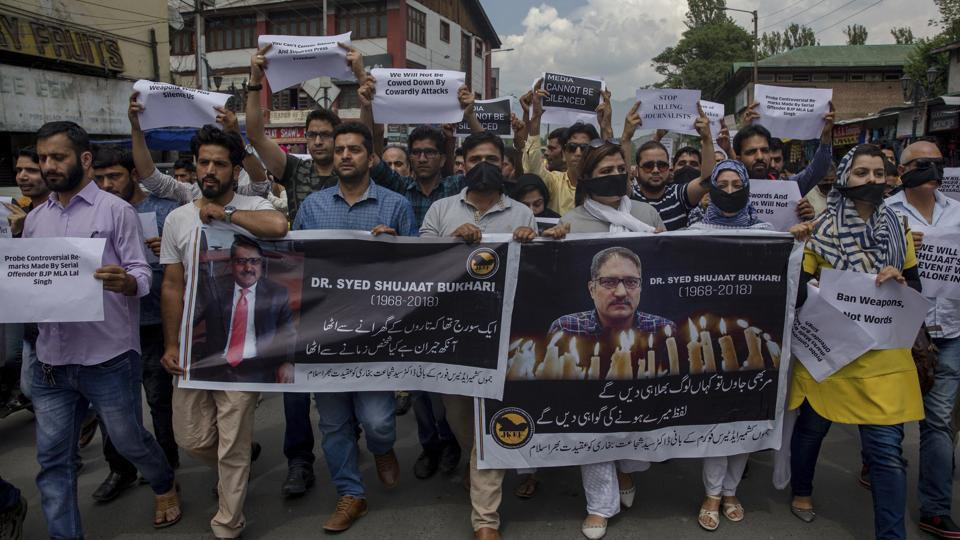 Kashmiri journalists hold banners and placards as they march during a protest against the killing of senior journalist Shujaat Bukhari in Srinagar on June 26, 2018. (Dar Yasin / AP)