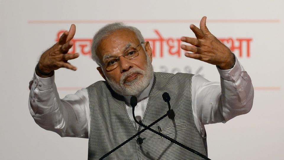 Prime Minister Narendra Modi gestures as he addresses Bharatiya Janata Party (BJP) supporters on the occasion of the 43rd anniversary of the imposition of