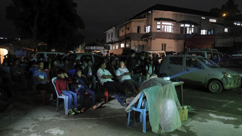 """People watch the Group F World Cup soccer match between South Korea and Germany in Kohima, Nagaland. Electricity is erratic here, but an order sent by state officials earlier this month made clear this was no ordinary time for Nagaland's power authority. Staff was """"directed to remain vigilant in their respective duties"""" and extra arrangements made. Why? """"For smooth maintenance of power supply during the World Cup matches,"""" the order read. (Yirmiyan Arthur / AP)"""