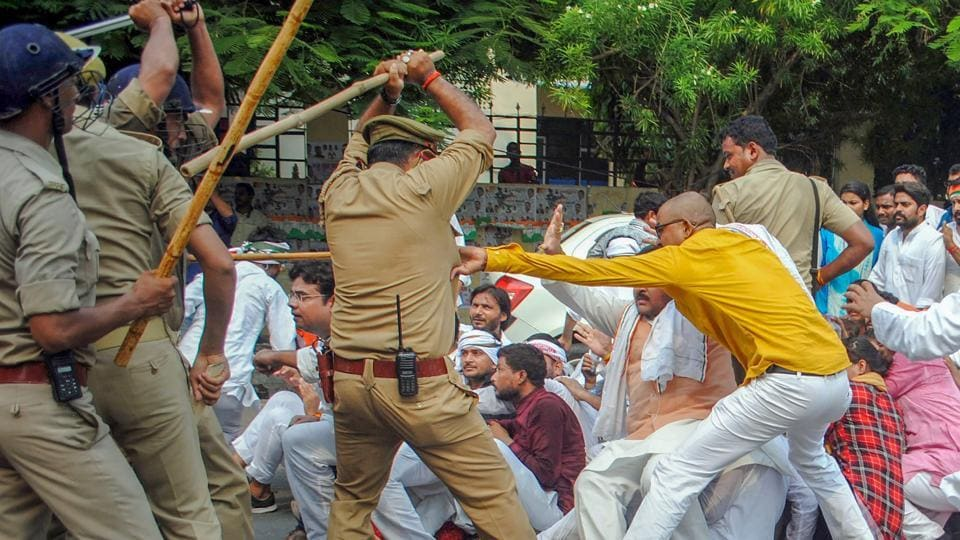 Police baton charge on Congress party's youth wing activists during their 'Save India' protest against the BJP government in Lucknow on June 26, 2018. (PTI)