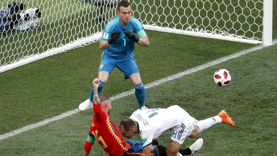 Sergei Ignashevich conceded an own goal as Spain took the lead against Russia. (AFP)