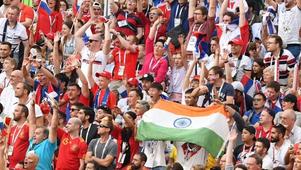 A fan waves an Indian flag during the World Cup match between Russia and Spain. (Utpaal SORKKAR/HT Photo)