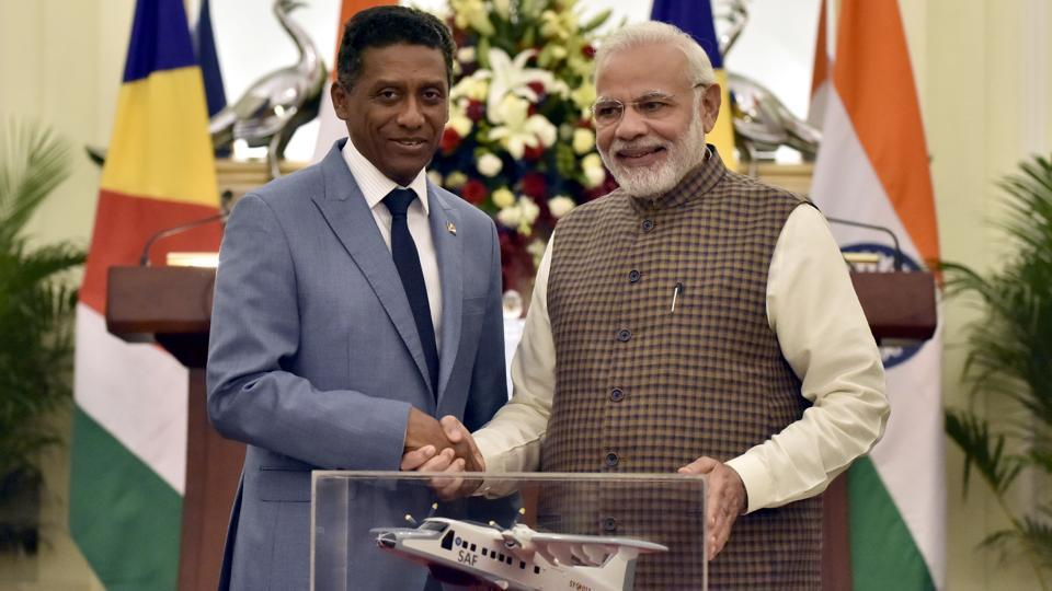 Prime Minister of India Narendra Modi shakes hands after handing over the replica of Dornier Aircraft to President of Seychelles Danny Antoine Rollen Faure, during a meeting at Hyderabad House in New Delhi on June 25, 2018. (Sonu Mehta / HT Photo)