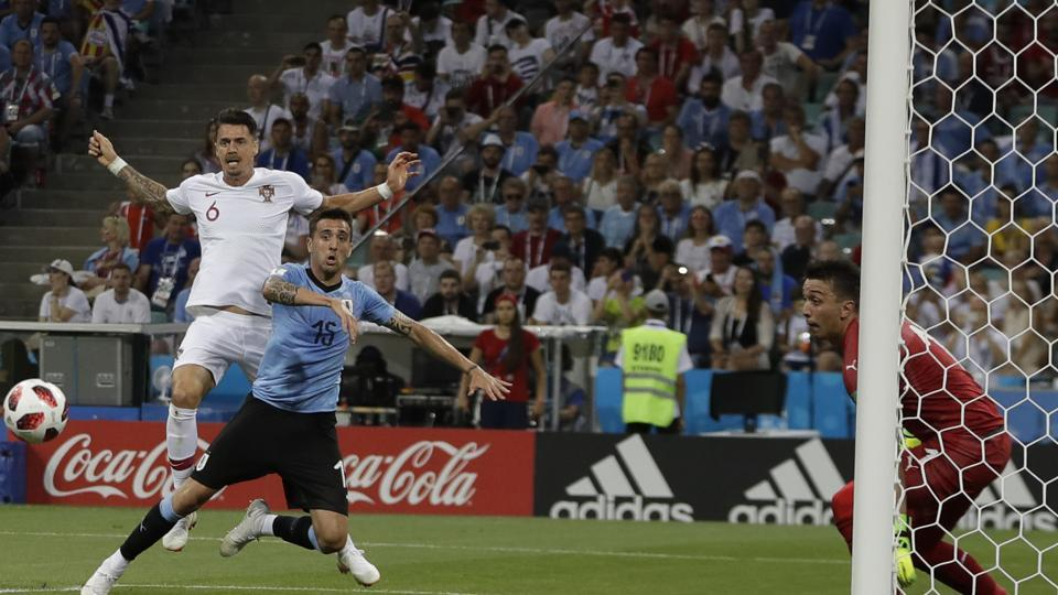 Uruguay goalkeeper Fernando Muslera, right, watches Portugal's Jose Fonte, left, challenging for the ball Uruguay's Matias Vecino, center, during the round of 16 match between Uruguay and Portugal. (AP)