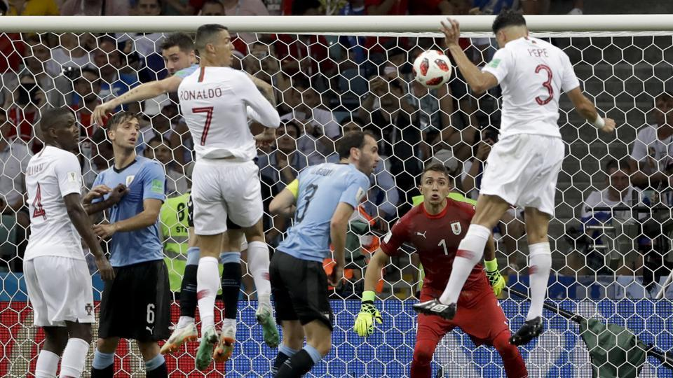 Portugal's Pepe, right, scores his side's first goal during the round of 16 match between Uruguay and Portugal. (AP)