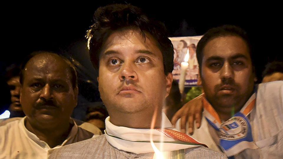 Congress leader and MP Jyotiraditya Scindia leads a candlelight vigil against the brutal rape case of 8-year-old girl in Mandsaur, in Indore on June 30.