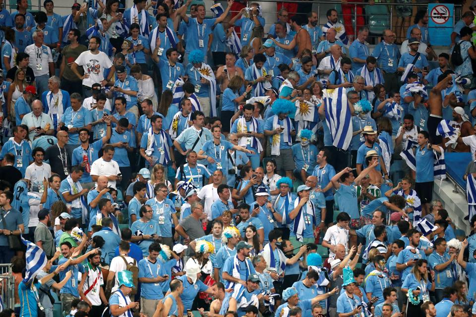 Uruguay fans celebrate at the end of the match. (REUTERS)