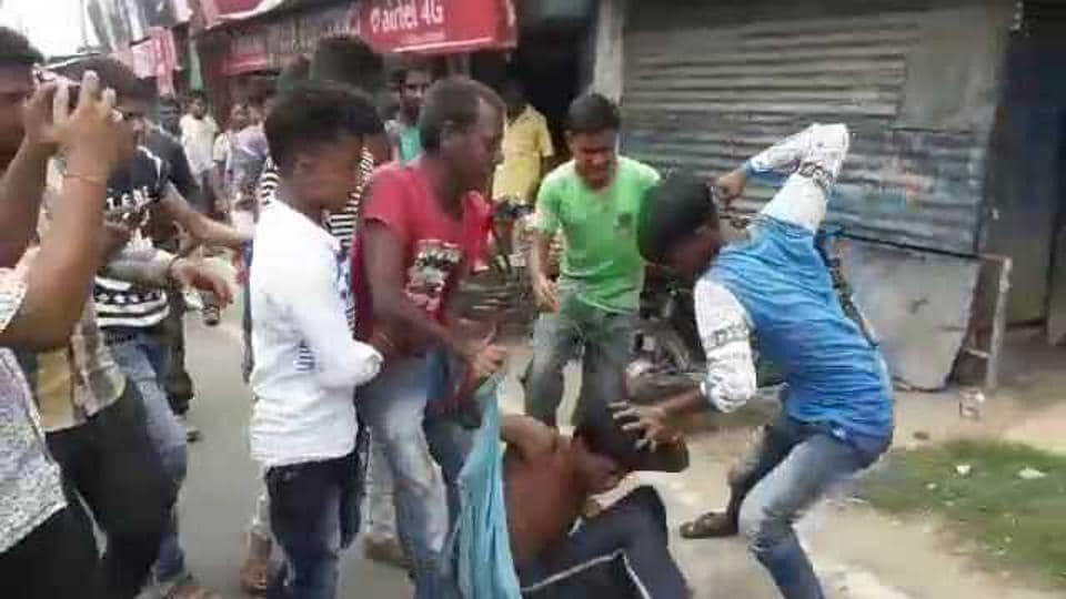 A mob in West Bengal's Malda attacking a man on June 22.