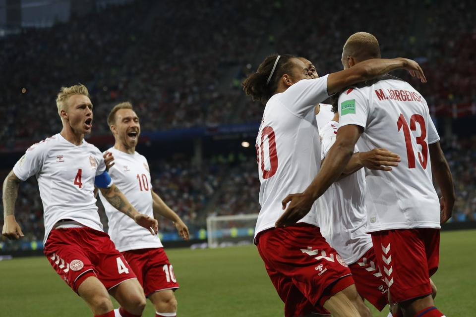 Denmark players celebrate after teammate Mathias Jorgensen, right, scored the opening goal. (AP)