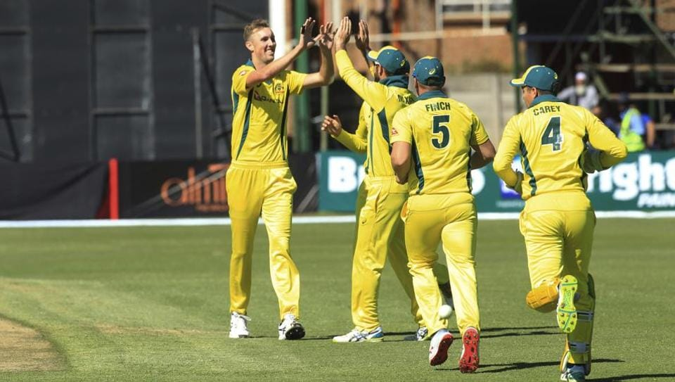 Australia's Billy Stanlake, left, celebrates with teammates the wicket of Pakistan's Shoaib Malik during their T20 match at Harare Sports Club, Monday, July 2, 2018.