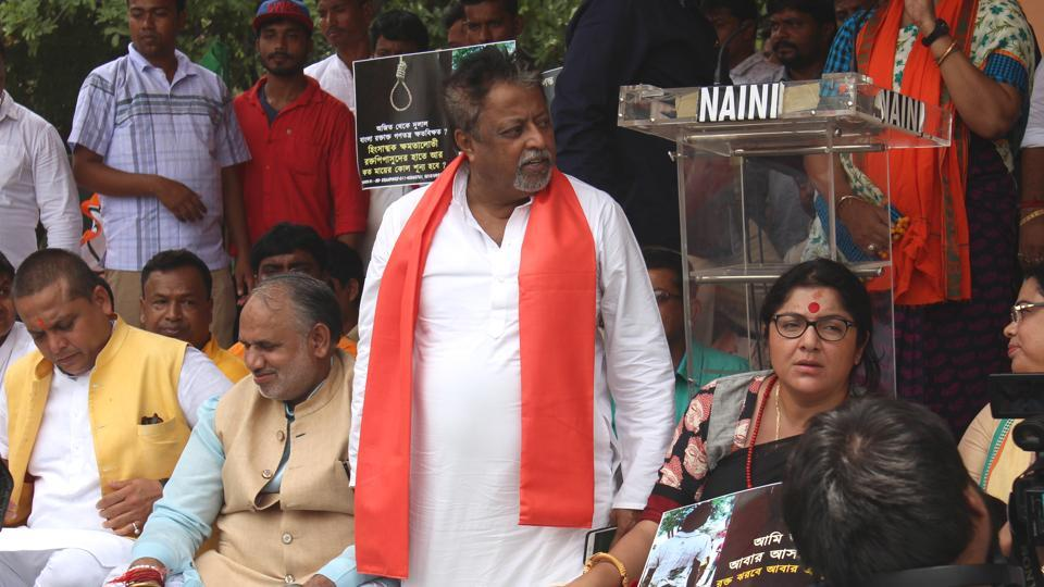 Mukul Roy and other BJP activists protests against killing of party workers in Bengal at Rajghat in New Delhi on July 2.