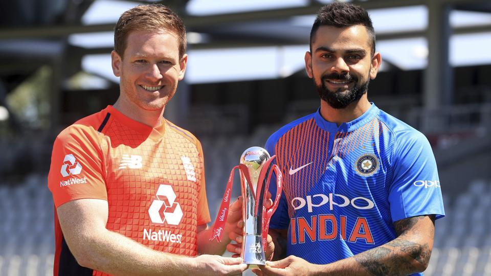 England's Eoin Morgan, left, and India captain Virat Kohli pose with the series trophy between nets sessions at Old Trafford, Manchester, on Monday.